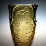 <strong>Hloušek Rudolf</strong> - <p>The vase, yellow transparent glass, etched motive of a&nbsp;girl in the sea waves. Marked Original R. Hloušek Žel. Brod, height 26 cm.</p>